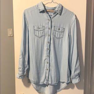 Light blue button up shirt.
